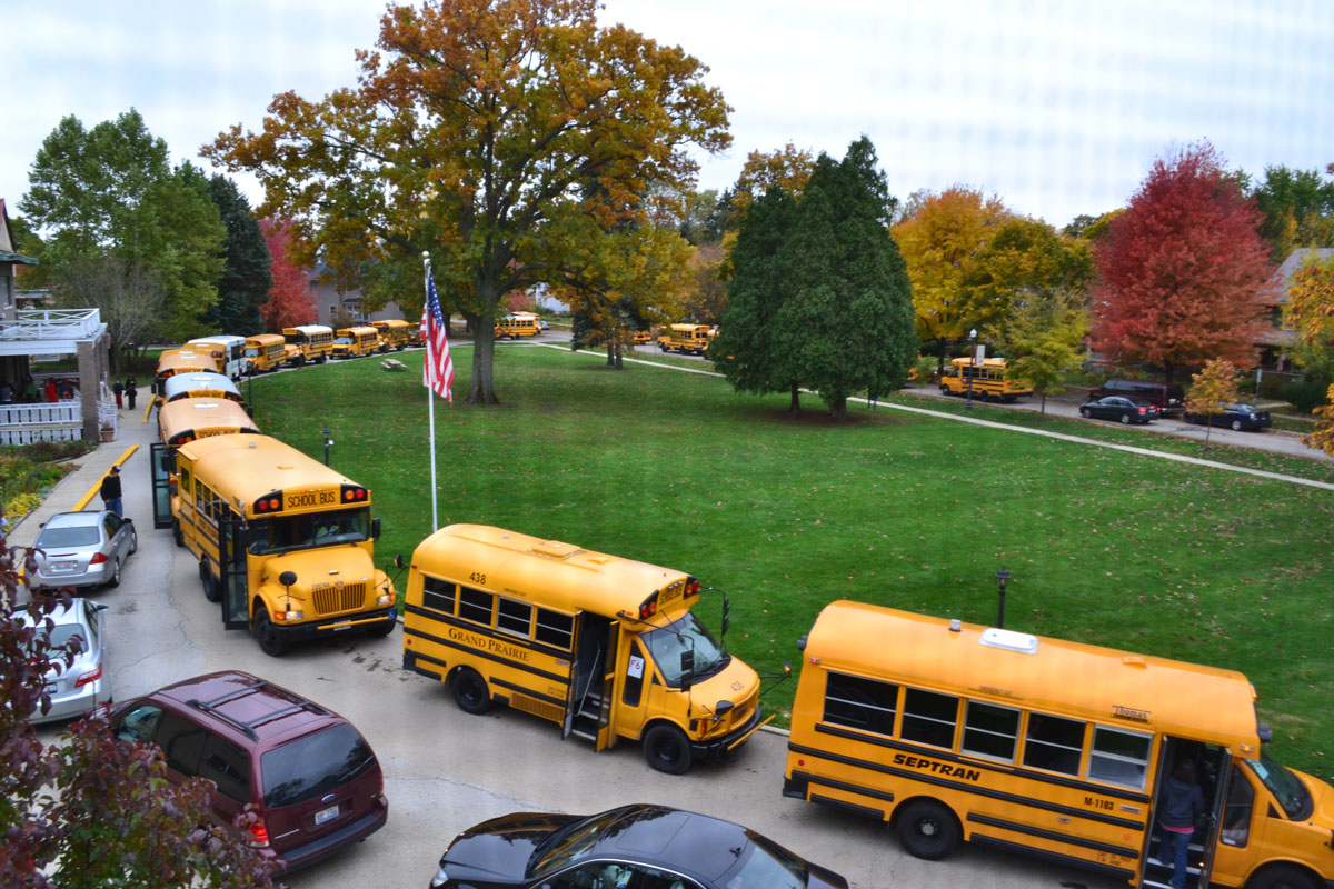 Buses provide transportation for students attending schools at Little ...