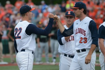 Illinois junior right-hander Nick Blackburn (22) greets a teammate during introductions prior to Illinois' game in NCAA Tournament against Ohio on May 29, 2015.