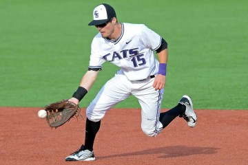 Kansas State redshirt senior first baseman Shane Conlon fields a ball against TCU. Photo Credit: Scott Weaver /  K-State Athletics